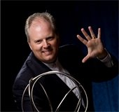 Male magician holding wire sphere