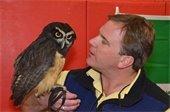 man holding owl