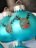 blue round ornaments with thumbprint reindeer