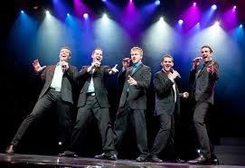 5 men singing