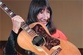 Nancy Tucker with guitar