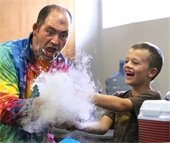 man and boy with dry ice