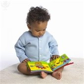 Baby boy looking at a book