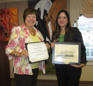 Library Board President Anna Eddy with American Eagle Federal Credit Union Newington Branch Manager Pam Golchin