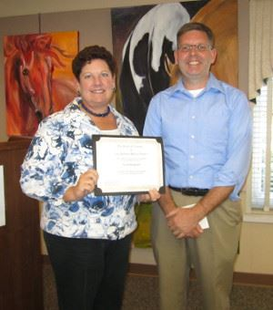 Library Board Trustee Diane Stamm with Scott Hoagland