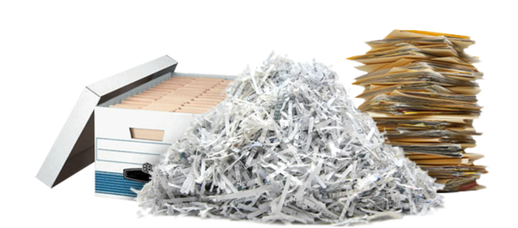 A pile of waste paper and folders, some shredded.