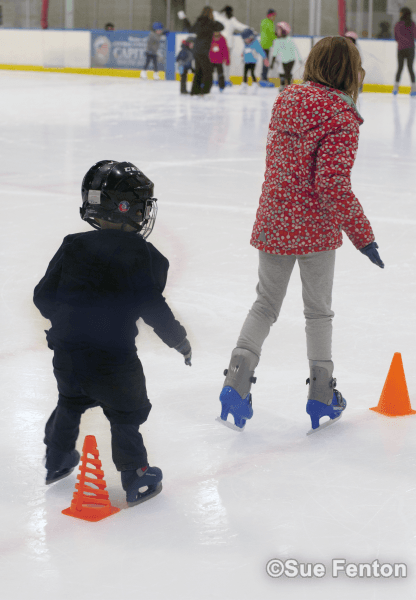Youth taking ice skating lessons