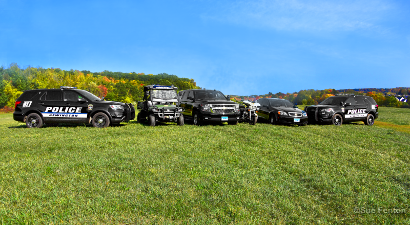 Staged photo of six fleet vehicles used by the Newington Police Department