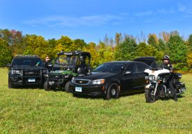 Photo of police department vehicles and motorcycle