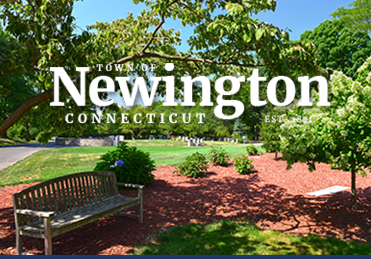 Park bench with cemetery in background with town of Newington logo