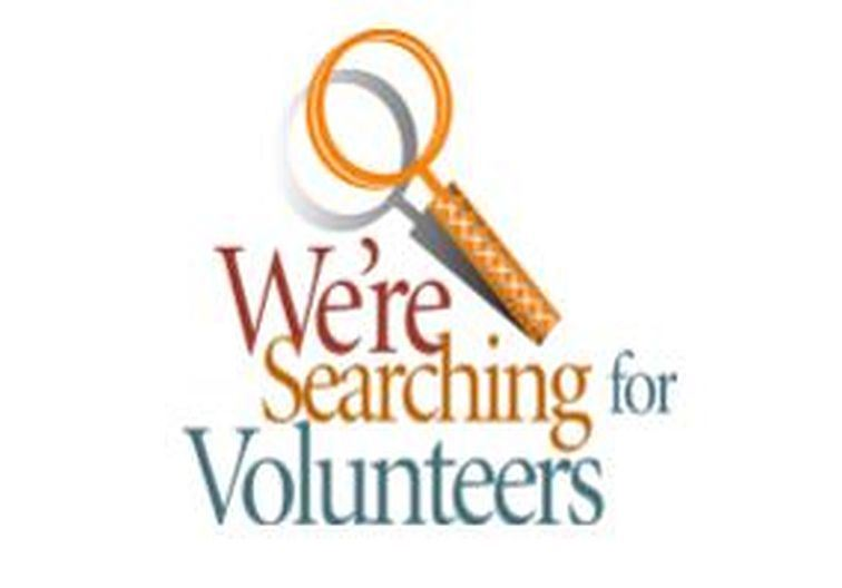 "Verbiage ""We're Searching for Volunteers"" with image of magnifying glass"